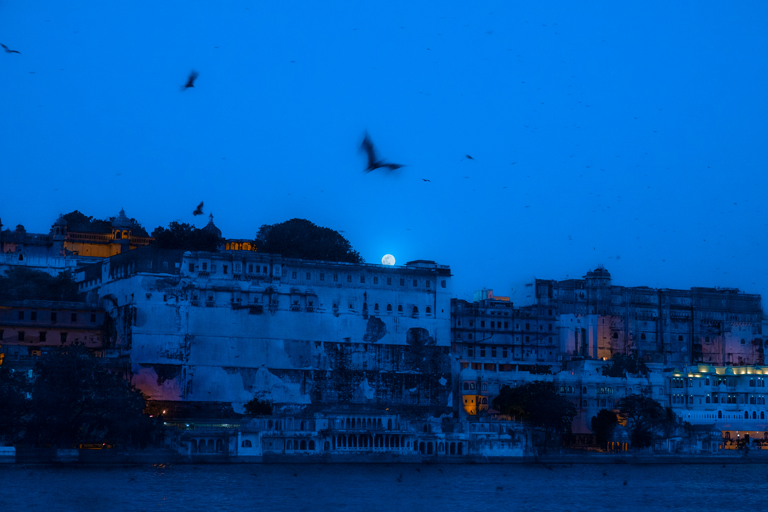 Full moon over Udaipur City Palace